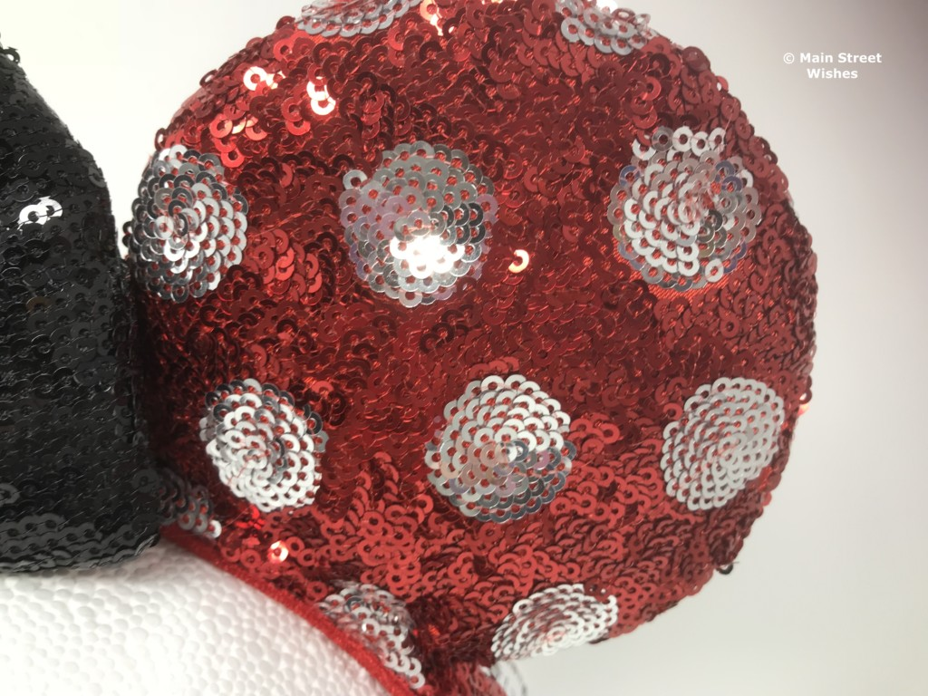 Black sequins cover the bow and it is filled with a soft material ded8d85d462b